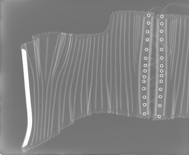 X-ray showing the position of the bones and metal busk © V&A Collection