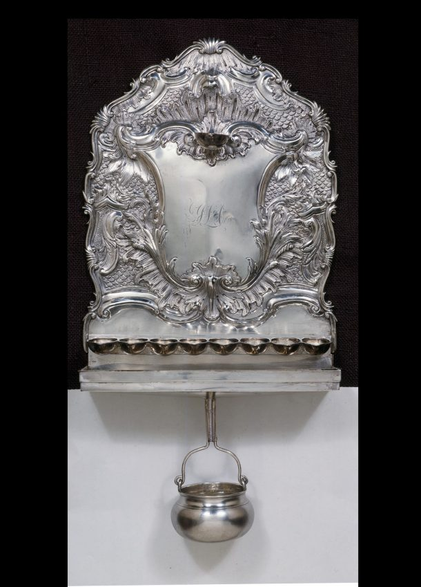 Hanukkah Lamp; silver. Height 39 cm, Width 25 cm The Victoria and Albert Museum, given by Miss Gladys Abecassis. Museum no. M.75&A-1949