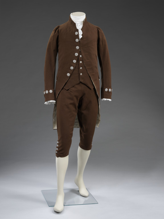 Man's suit of coat, waistcoat and breeches, dark brown wool, lined with silk and linen, with cut steel buttons. French, ca.1780. V&A T.10:1to3-2010