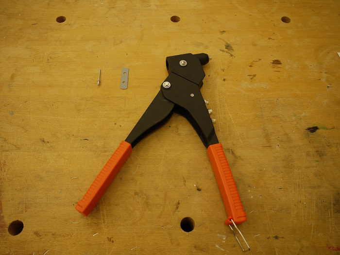 Left to right: rivet, rivet plate, riveter