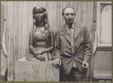 2803-1938 Frank Dobson (1887-1963) Photograph of Frank Dobson standing next to a sculpture by him of a girl done in bronze
