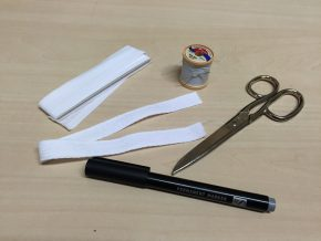 Textile marking kit. The permanent museum number of a recently acquired object is written on a piece of cotton tape and sewn on to the object. © Behnaz Atighi Moghaddam