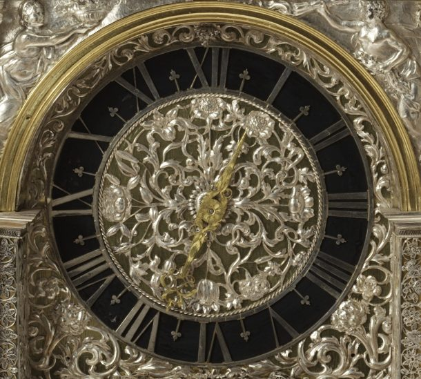 Tulips, marigolds and carnations decorate the clock faces. Cast in silver, the passage of time cannot wither them, unlike the real flowers after which they are modelled.