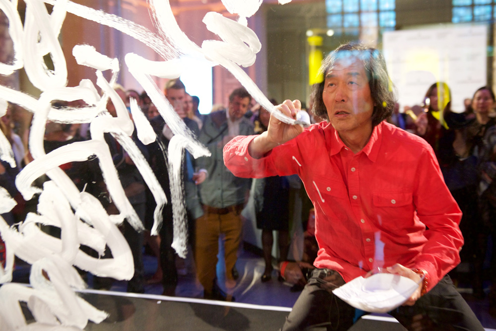 Wang Dongling writing out the text of his calligraphic performance