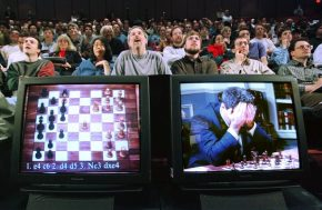 World chess champion Garry Kasparov rests his head in his hands as he is seen on a monitor during game six of the chess match against IBM supercomputer Deep Blue , May 11, 1997. The supercomputer made chess history Sunday when it defeated Kasparov for an overall victory in their six game re-match, the first time a computer has triumphed over a reigning world champion in a classical match. Kasparov resigned after 19 moves. REUTERS/Peter Morgan