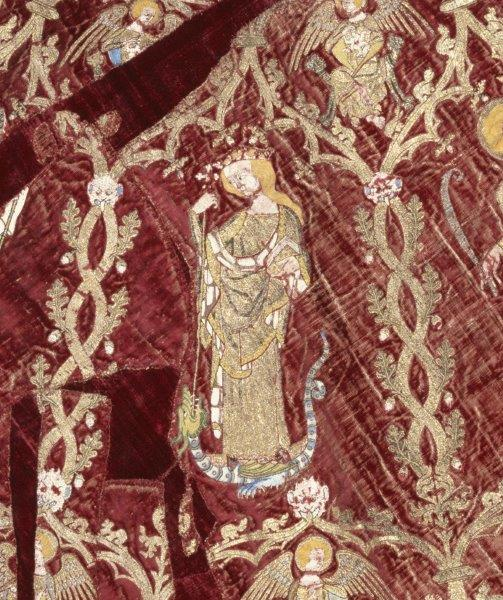 Detail from the Butler-Bowden cope: St. Margaret standing on a writhing dragon, piercing it with a long-stemmed cross, England (made), Italy (woven), 1330-1350. Museum Number: T.36-1955 © Victoria and Albert Museum, London