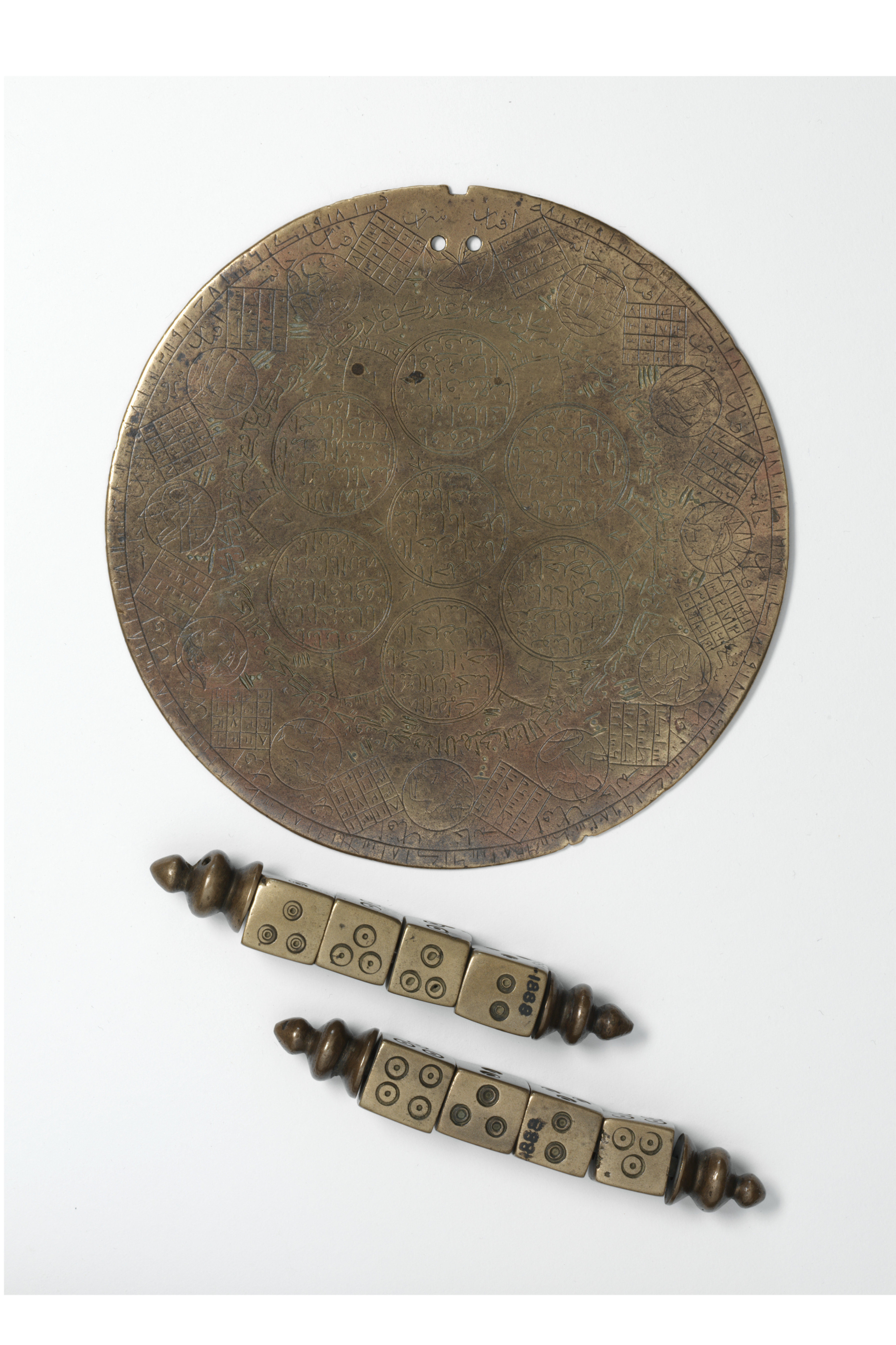 Dice and plaque, Iran, 1600-1700. Cast and engraved bronze. Museum number: 505-1888 © Victoria and Albert Museum. The art of using dice for fortune-telling was developed at least 4000 years ago, long before dice were first used to play games.