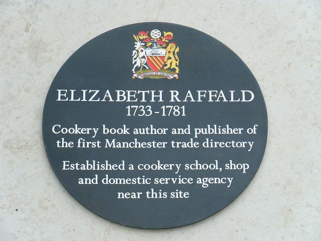 The Black Plaque on the Marks and Spencer's building, 7 Market Street, in Manchester, to commemorate Elizabeth Raffald's work in the city.