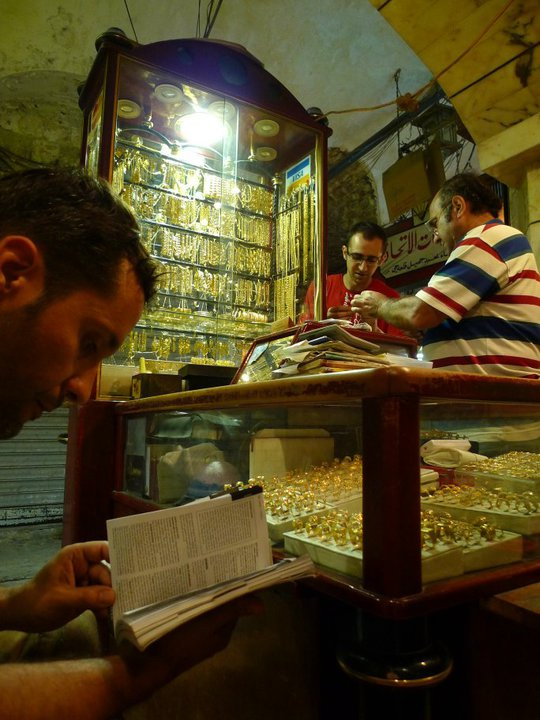 Victor (seated on the left) in the gold shop where he purchased the pendant from the Armenian goldsmiths in Aleppo.  © Victor Borges