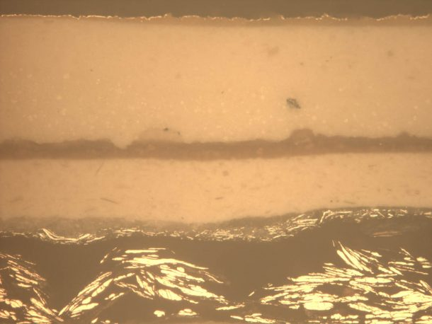 Figure 3: Sample 2 from the Angel viewed under a microscope and showing clearly the colour and texture of the metallic layers.
