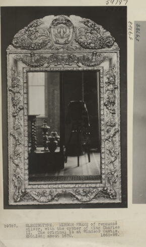 Mirror frame; a Victorian electrotype of repoussé silver, with the cypher of King Charles II, the original is in Windsor Castle, showing a reflection of the camera and gallery displays, in 1928