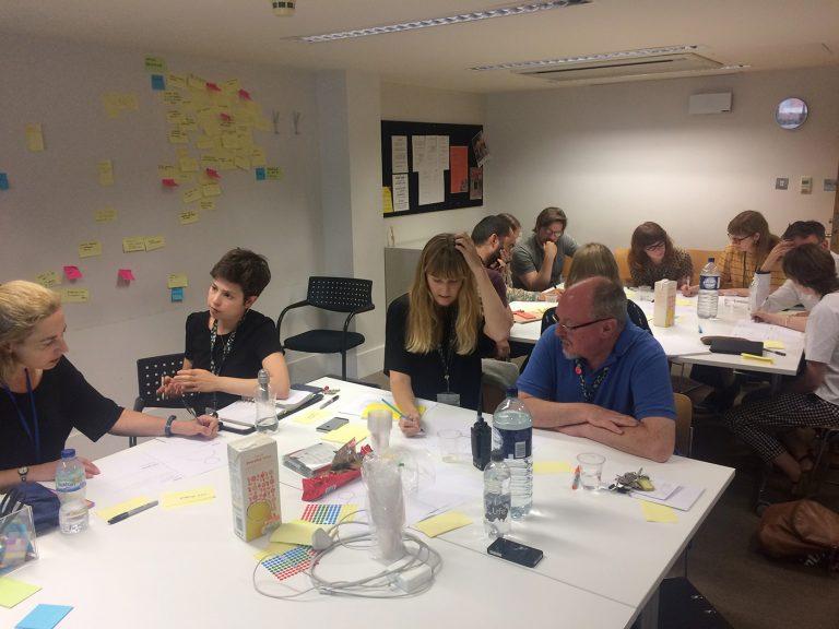 V&A staff talking together in a workshop
