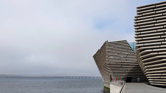 V&A Dundee sitting on the Tay with mist beyond obscuring Fife