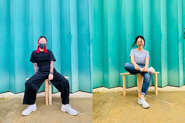 Ji Ji and Minyi Zhang model their stools made for the Food Waste Feast