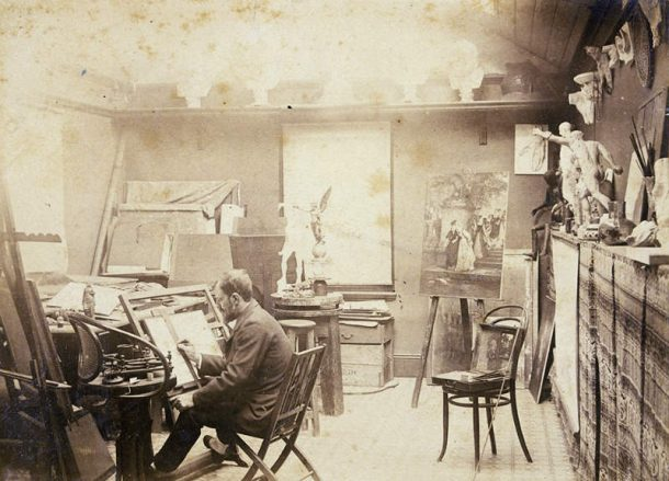 Lucien Henry (1850-1896) in his studio 1890. Note the cast of David's ears in the upper right corner of the photo.