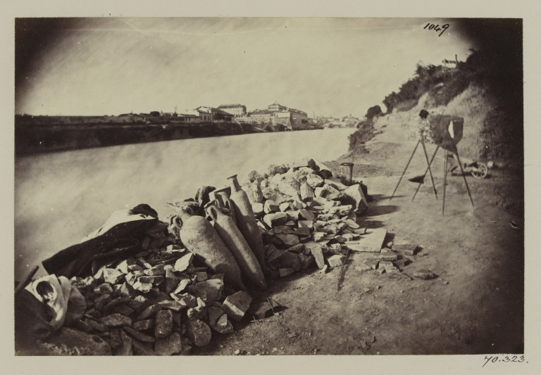 Photograph of Roman amphorae on the banks of the Tiber, Rome, with the photographer's camera visible at the right