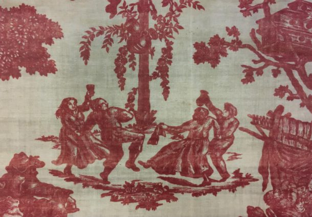 Four figures dancing around a Maypole design