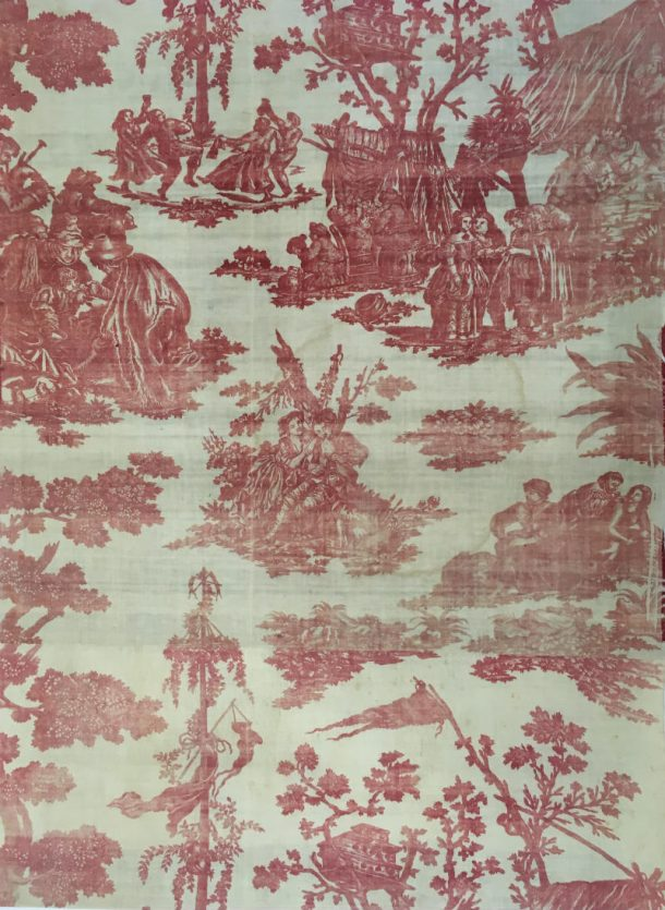 Furnishing fabric of plate-printed cotton in red. Three blue warp threads in each solvedge. With a scene with a fortune-teller.