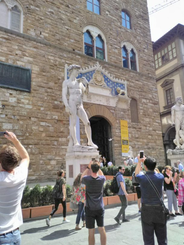 Figure 12 Tourists taking pictures of the marble copy of Michelangelo's David in Piazza della Signoria, Florence, August 2017 (picture by Giuliana Videtta).