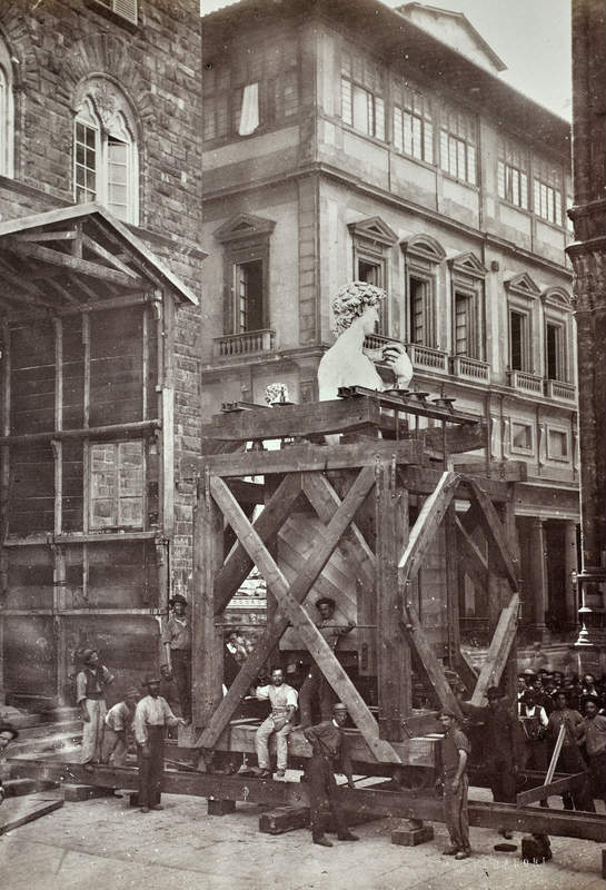 Michelangelo's David inside a wagon in Piazza della Signoria just before being transported on rail to the Academy of Fine Arts of Florence, 31/07-04/08 1873. Photographer: Vincenzo Paganori (credit: Alinari Archives, Florence).