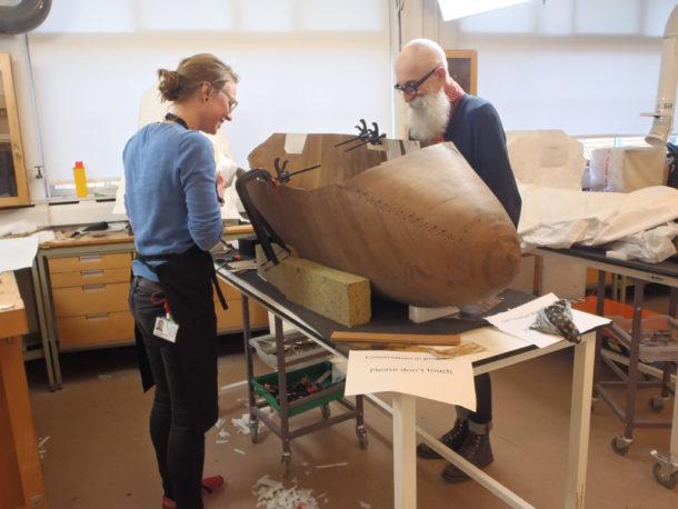 Janna Mostert and Nigel Bamforth adhering Reemay with hide glue