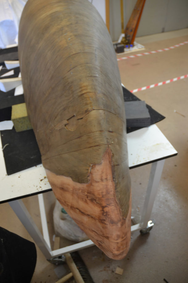 Tail reconstruction attached to the body of the tank