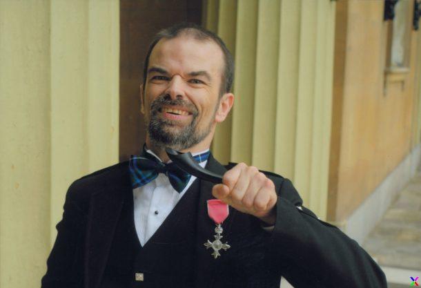 Grant Douglas receiving MBE.
