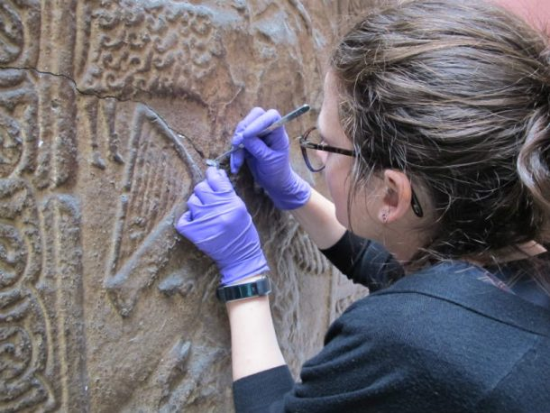 Valentina Risdonne taking samples from the Pictish Cross. Image, Johanna Puisto © Victoria and Albert Museum, London.