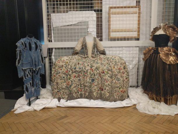 Vivienne Westwood denim ensemble, 1740s embroidered mantua, and Zandra Rhodes dress