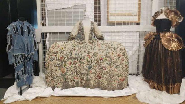 Recent returns L-R: Vivienne Westwood denim ensemble, 1740s embroidered mantua, and Zandra Rhodes dress