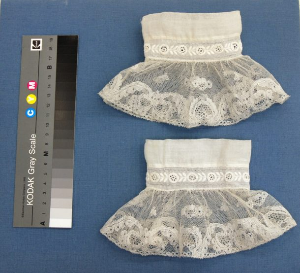 Lace cuffs from the textile conservation department handling collection. Both cuffs cleaned in a 0.2% solution of Dehypon LS54 in deionized water. Upper cuff sponged for 2 minutes, lower cuff treated with 2 minutes of ultrasonic waves in 3 second bursts.