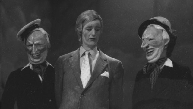 "Figure 2. An archival image from ""Short Sharp Shock"", illustrating that several Edward Heath masks were used in the production"