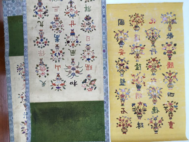 Figure 1. Embroidered silk panels showing the colour of both front and back and the original Korean green damask © Victoria and Albert Museum, London