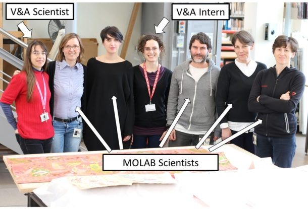 Figure 2: MOLAB 1 A visiting scientists in front of a textile made to Leman's design (T.156-2016). Photography by Eileen Budd © Victoria and Albert Museum.