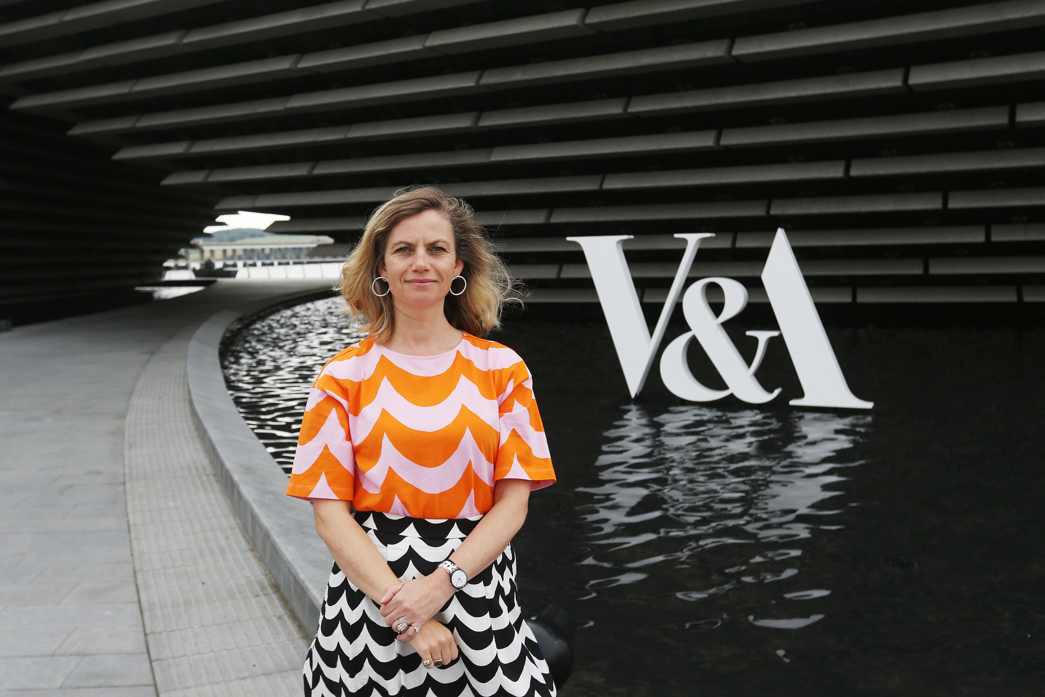 Woman standing outside of V&A Dundee