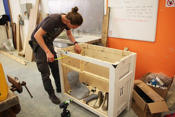 Liam Motyer measures the drawers for John's writing bureau, which will also incorporate mannequin parts from the V&A