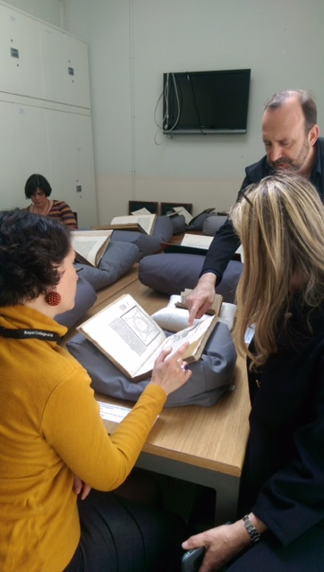Guido Beltrami shows students a sixteenth-century-edition of Vitruvius's The Ten Books on Architecture