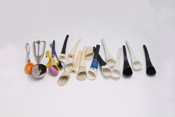 A whole range of modified sup spoons in a row, showing different prototypes.