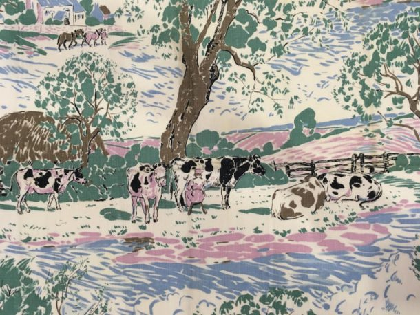 Close up of milkmaid and cows under a tree design