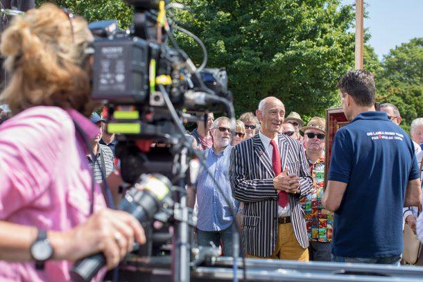 film crew filming Antiques Roadshow experts.