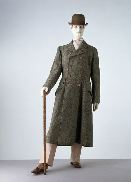 Mannequin holding pear wood walking stick T.82-1982, given to the Museum by Mr Ivor Montague