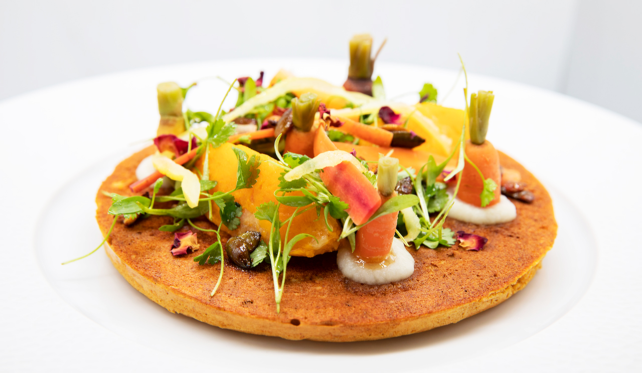 Savoury, spiced chickpea crumpet with fermented carrots