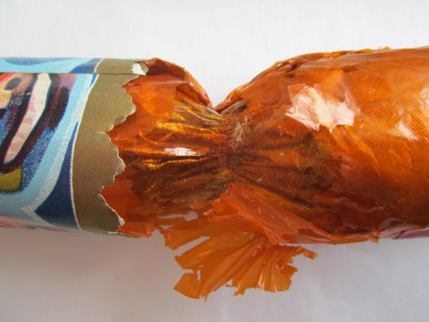 'Totem Cracker' during conservation, showing the coloured Visking Dialysis Tubing inserted beneath the loose flaps of the original orange gelatine film