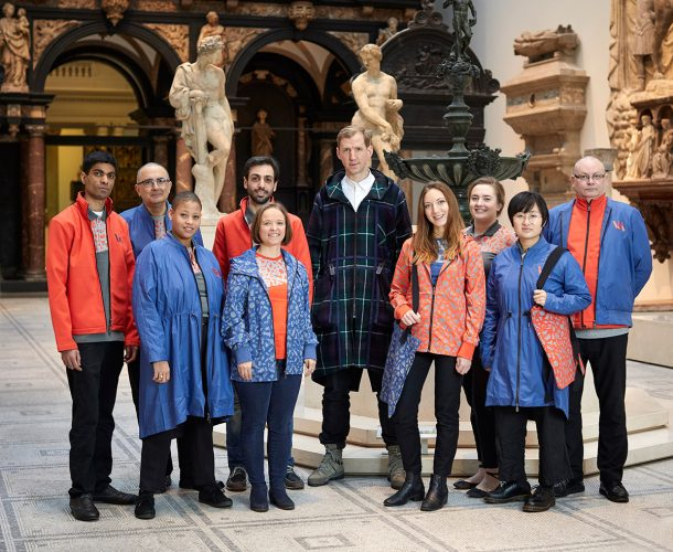 V&A staff in the new uniforms with designer Christopher Raeburn © Victoria and Albert Museum, London / Christopher Raeburn