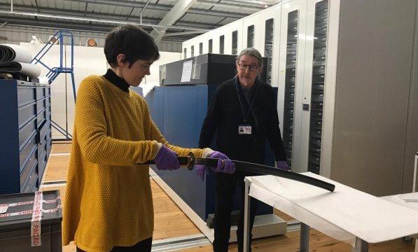 V&A staff prepare to unsheathe a Japanese sword
