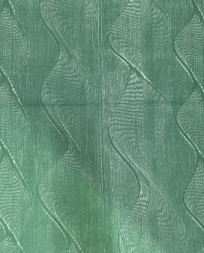 Screen printed cotton with a dark green wave pattern on light green ground.