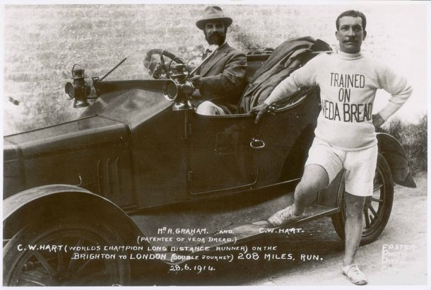 Photograph showing the founder of Veda, Robert Graham, with the championship long-distance runner C.W. Hart