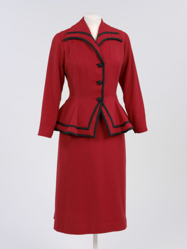 Red wool and mohair jacket and skirt suit with fine black polka dots, 1948